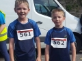 Gormley twins at finish of 5k.jpg